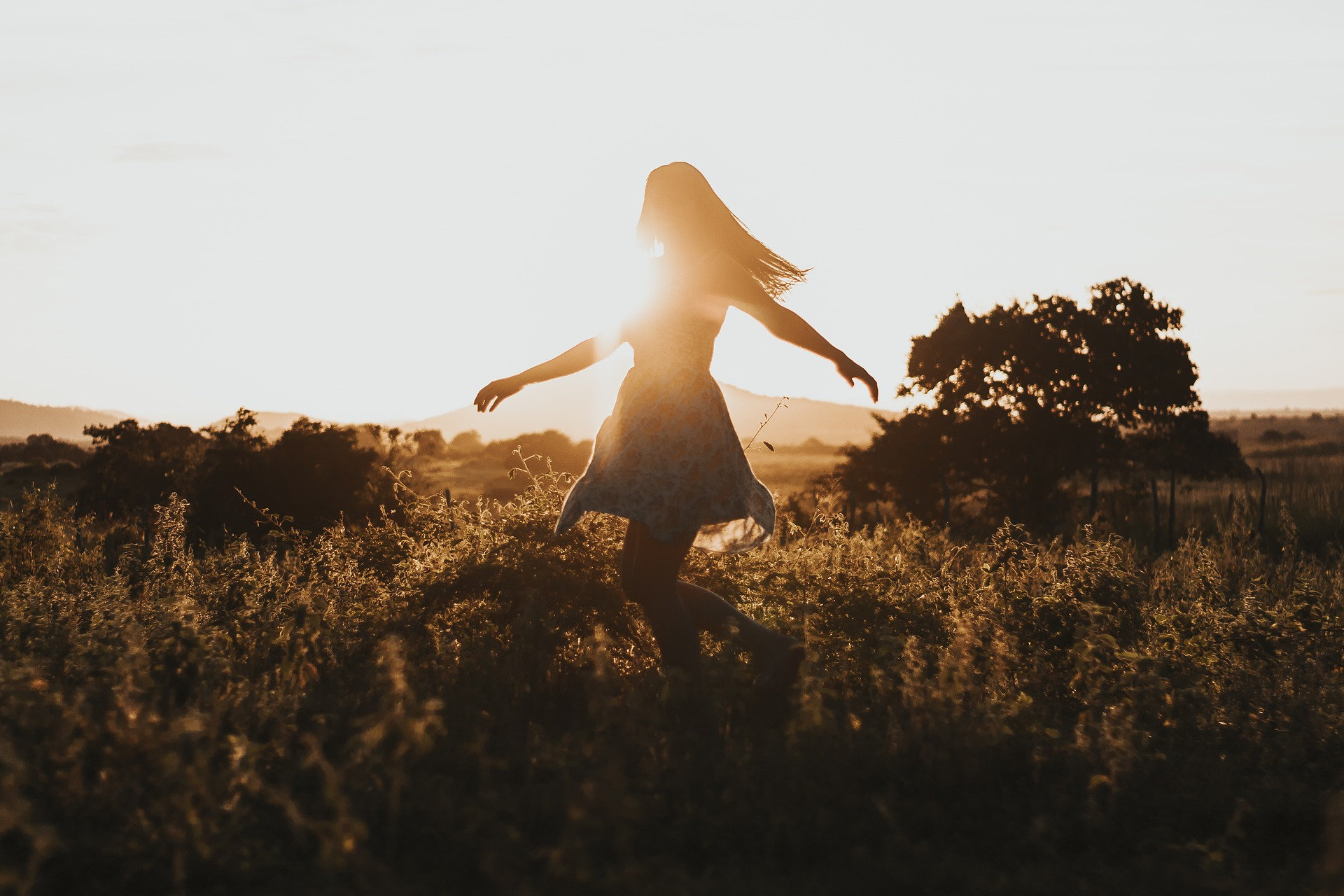 ideas for self care depicted by carefree girl in field