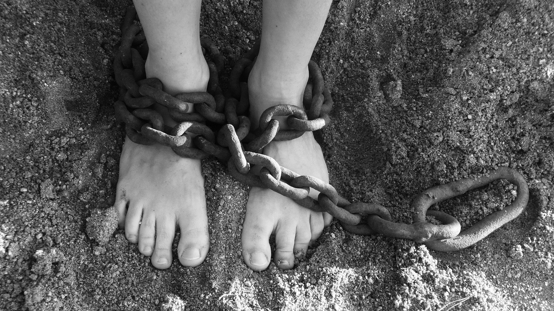 a lack of empowerment depicted by chains on feet.
